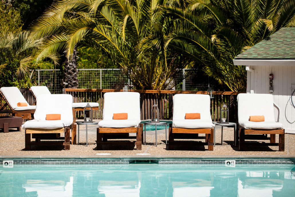 boon hotel + spa lounge chairs by pool
